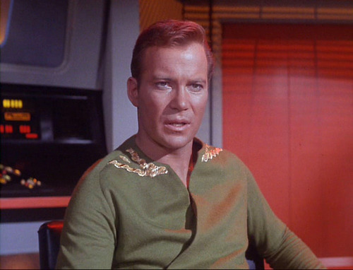 Captain Kirk in green wrap shirt