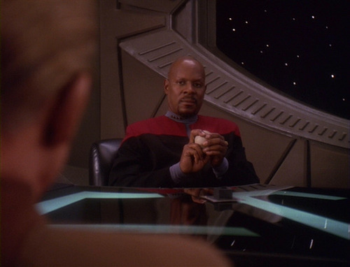 Sisko holds his baseball and talks to Odo