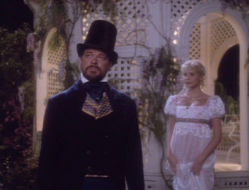 Riker and Amanda in a Jane Austen-esque setting and costumes