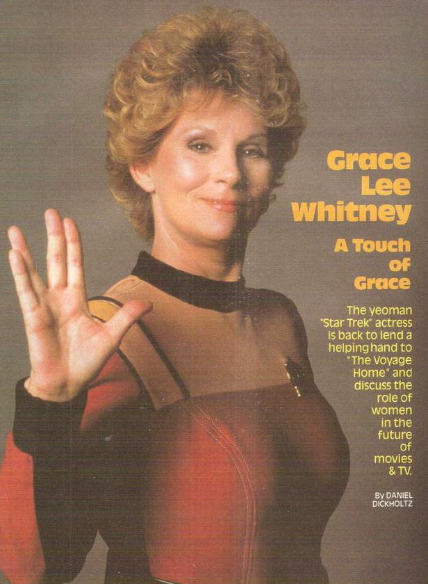 Photo of Grace Lee Whitney giving Vulcan salute wearing TOS movie uniform
