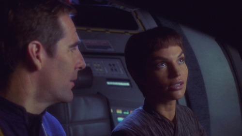 Archer and T'Pol survey the damage