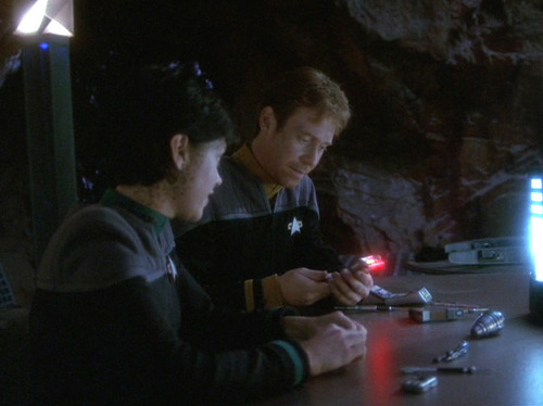 Exri and Kellin work on reconfiguring tricorders
