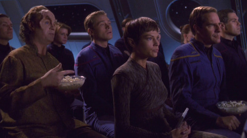 Phlox and Trip sit behind T'Pol and Archer at the movie
