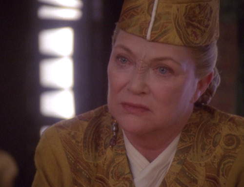 Louise Fletcher as Winn Adami