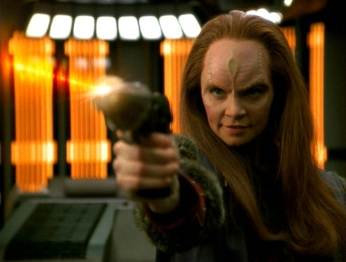 Seska with a phaser after being discovered to be a Cardassian.