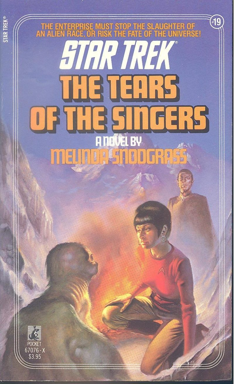 Cover of Tears of the Singers, showing Uhura near a campfire with a seal-like alien