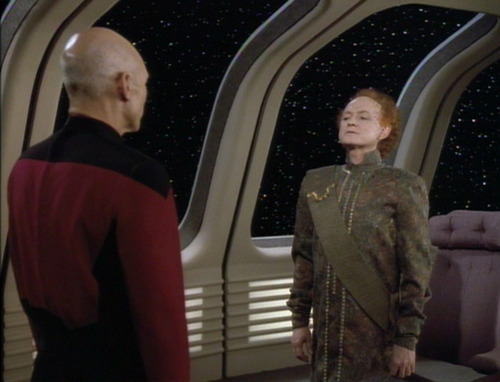 Picard greets Alrik of Valt, a short, red-headed man in a green tunic