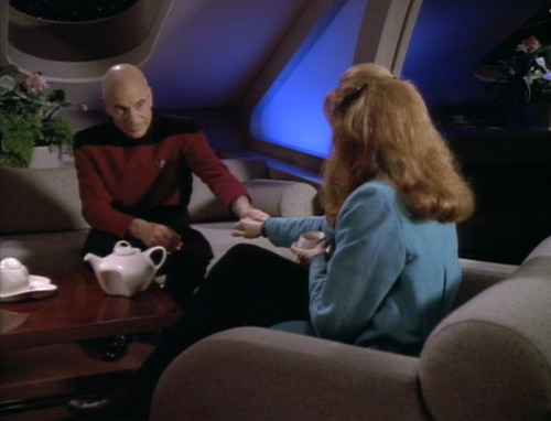 Picard and Crusher clasp hands over tea
