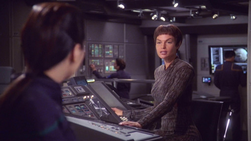 T'Pol talks to Hoshi, each at their bridge station