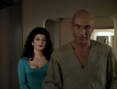 Troi stands behind Picard as he readies for his trip