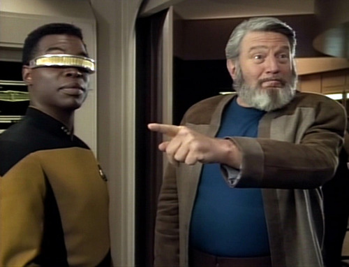Sergey Rozhenko points at something in Engineering as Geordi looks