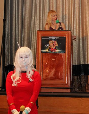 Mary Czerwinski at a podium and Karine Marois as an Andorian TOS officer in front