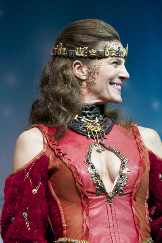 Terry Farrell close up of head and shoulders in Klingon dress