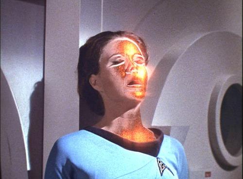 Mira Romaine possessed by gold lights