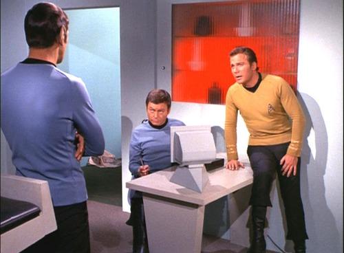 Kirk, Spock and McCoy talk in Sickbay