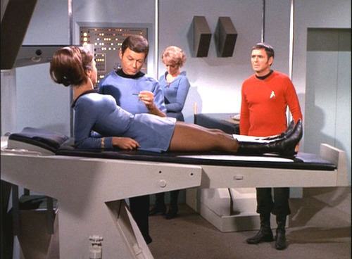 Romaine sits up in Sickbay