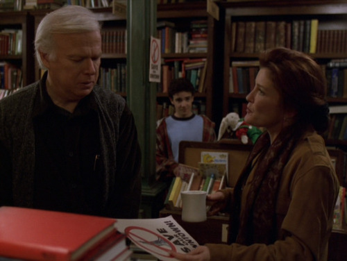 Shannon talks to Henry Janeway in his bookshop