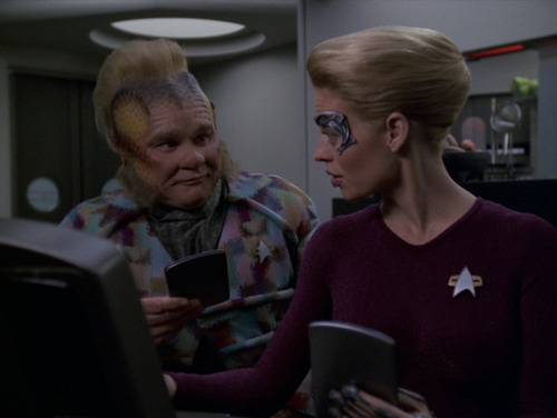 Neelix and Seven look at a computer in the Mess Hall