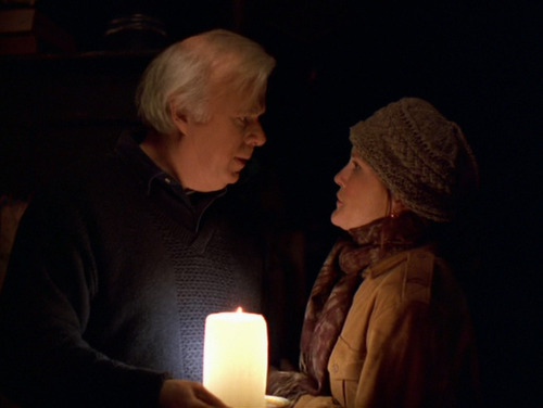 Henry and Shannon in candlelight after the power is cut