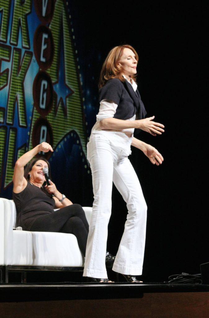 Gates McFadden dancing while Marina Sirtis laughs