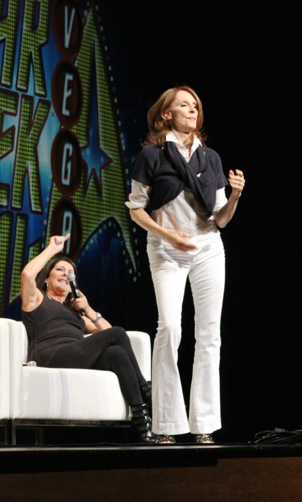 Gates dancing while Marina Sirtis points