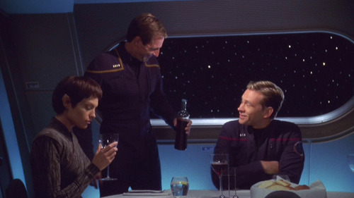 Archer pours wine for T'Pol and Trip