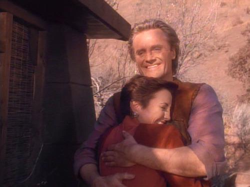 Kira and Shakaar hug happily outside his home