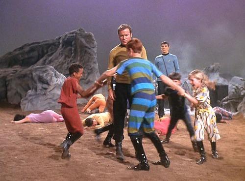Kids dance in a circle around Kirk
