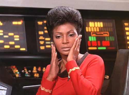 Uhura touches her face with relief