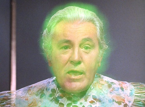 Gorgan - an old white man in a floral robe, who glows green