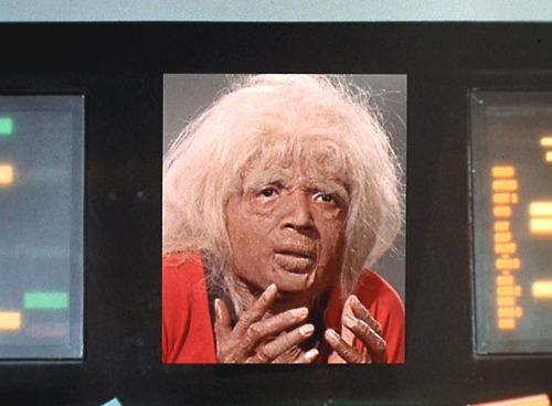 Uhura in aging makeup, looking shocked