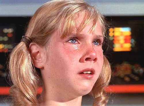 Little girl crying on the bridge