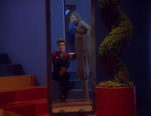 The Clown points to himself and Janeway in a mirror