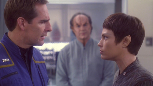 Archer and T'Pol face off while Phlox watches