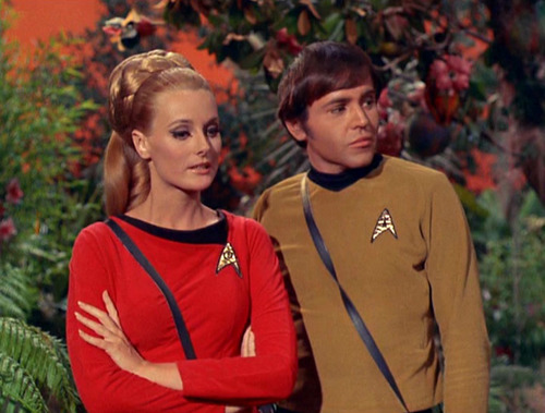 Celeste Yarnall as Martha Landon standing next to Walter Koenig as Chekov