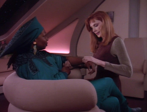 Crusher treat's Guinan's tennis elbow in her quarters