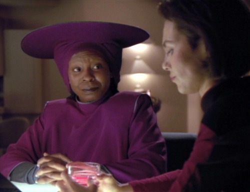 Guinan and Ro talk in Ten Forward