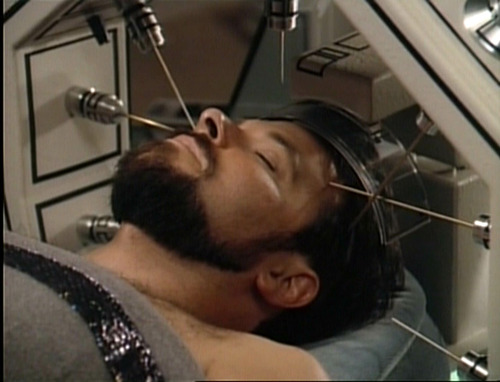 Riker in Sickbay biobed with needles coming out of a machine into his head