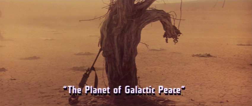 "Desert and caption ""The Planet of Galactic Peace"""