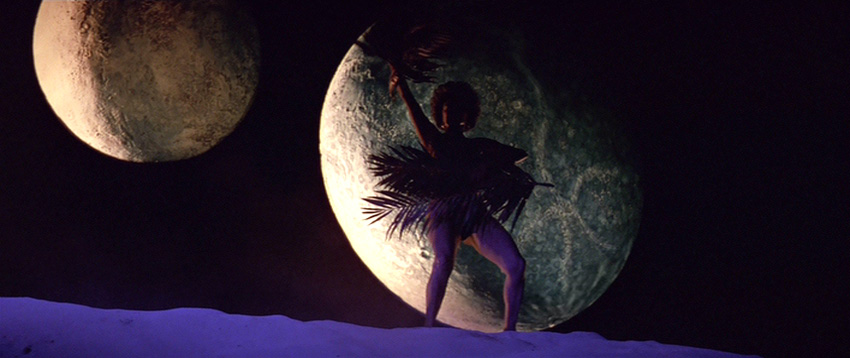Uhura silhouetted against a moon with fans