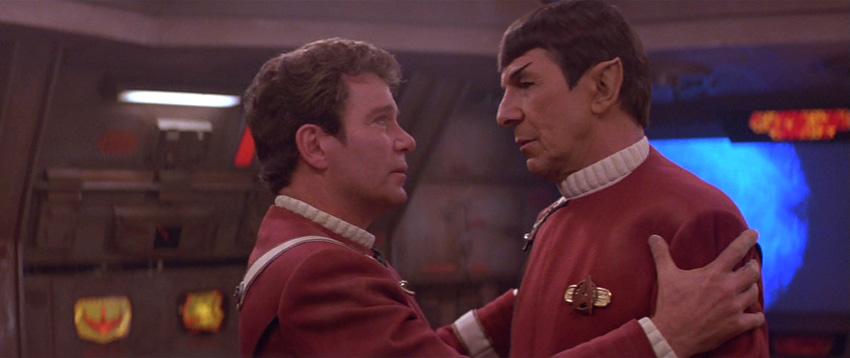 Kirk grasps Spock's shoulders