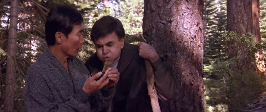 Chekov blows into Sulu's communicator