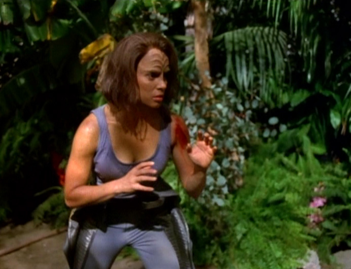 B'Elanna in her undershirt getting ready to fight Vork