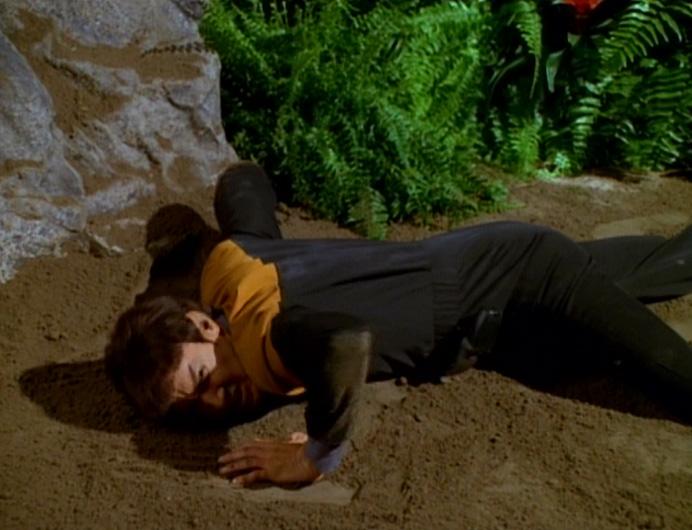 Vorik cringes on the ground