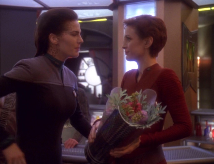 Dax talks to Kira, who is holding flowers