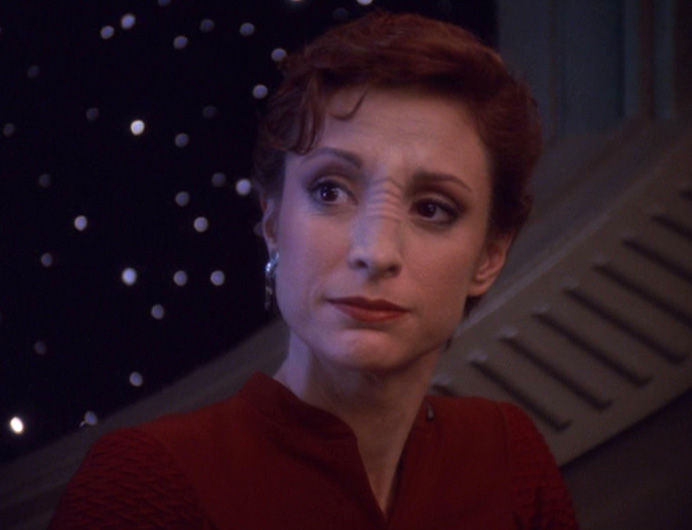 Kira looks sadly at Sisko