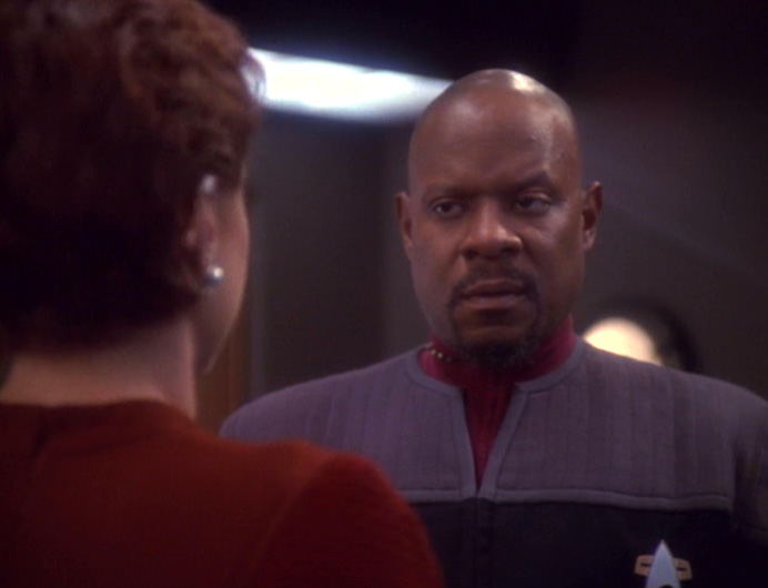 Sisko looks skeptically at Kira