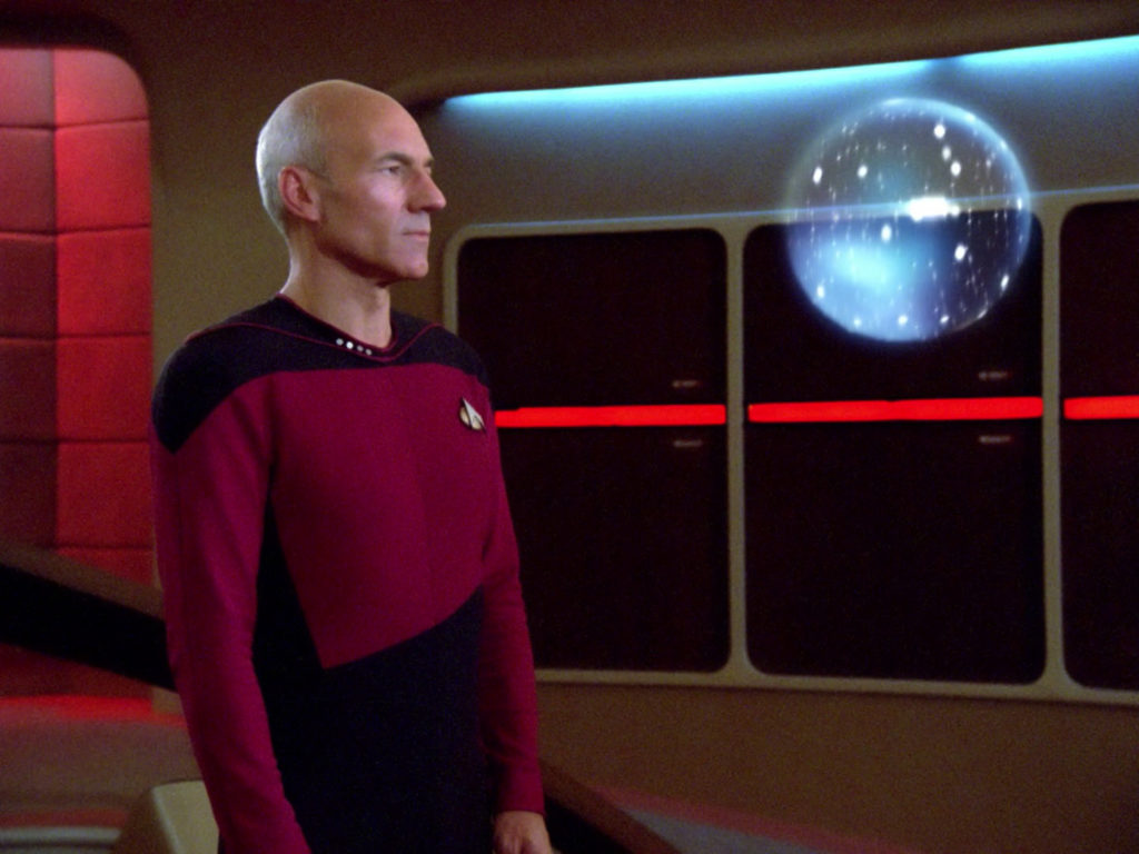 Picard looks at the orb on the bridge