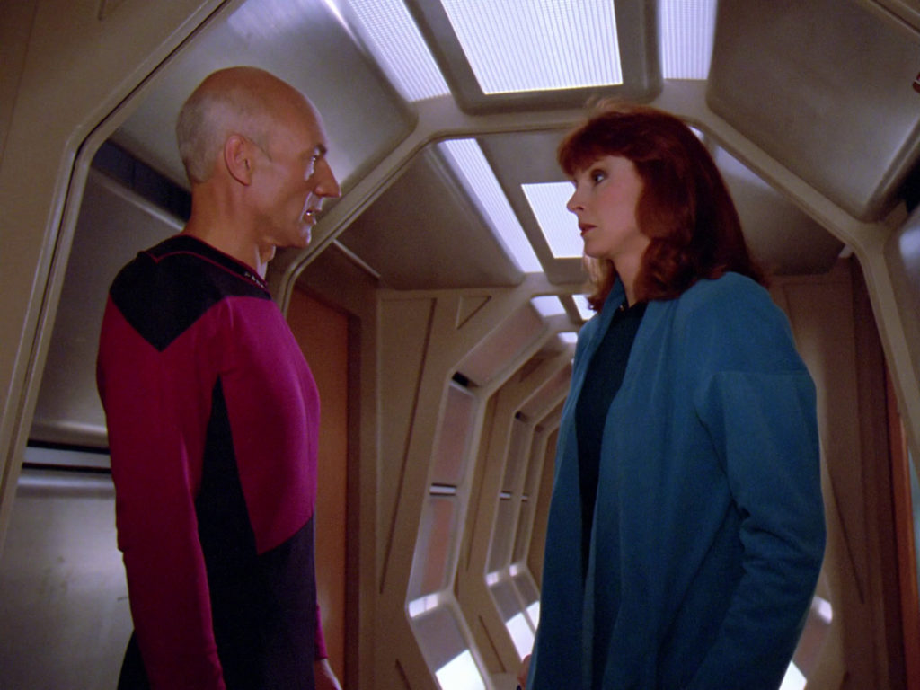 Picard and Crusher argue in the corridor