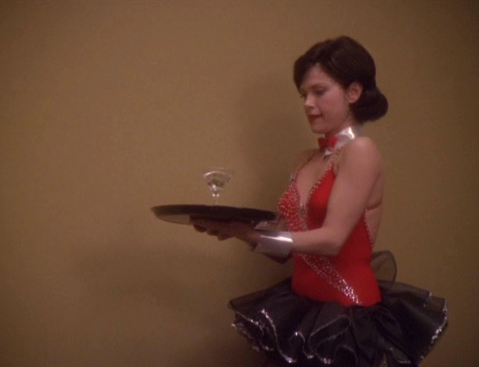 Ezri carrying a drink on a tray